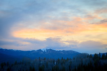 Snow capped mountain landscape at sunset near forest in Apraho National Forest, Colorado