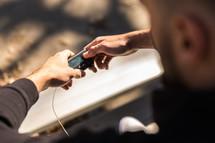 man monitoring his blood sugar