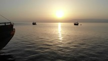 Flyby of ships on the Sea of Galilee in Israel at sunrise.