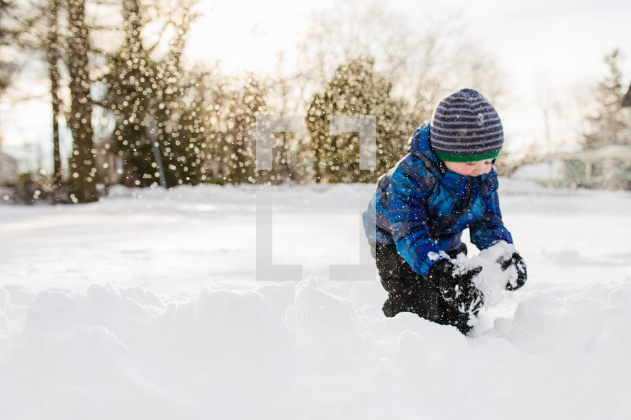 child making a snowball