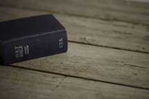 A Bible on a wooden table