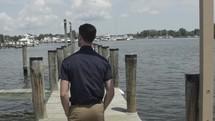 man walking on a dock