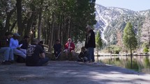 men's group discussing scripture outdoors