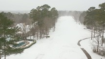 aerial view over a snow covered golf course