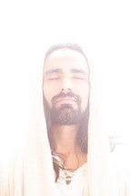The resurrected Christ -- a hooded Jesus in a ray of light.