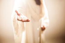 Jesus extending His hand as an invitation to follow Him.