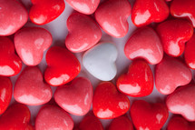 white heart candy and red heart shaped candy