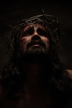 The suffering of Christ -- Jesus agonizing in pain in His crown of thorns.