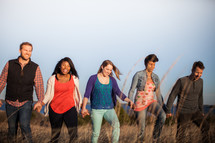 group of people walking holding hands in fellowship
