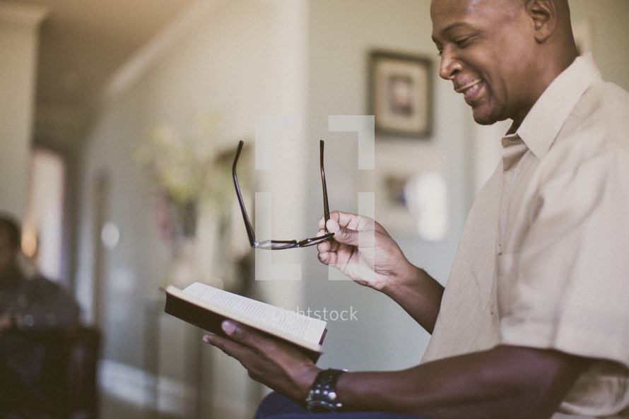 man reading a Bible to others
