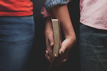 couple holding a Bible together