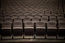 Rows of empty seats in an auditorium.