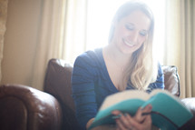 A woman reading a Bible at a Bible study
