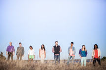 group of people standing outdoors in a field
