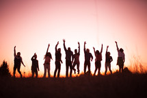 jumping, raised hands, praise, man, woman, silhouettes, group, people, row, standing, field, outdoors, worship