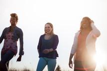 women laughing walking outdoors