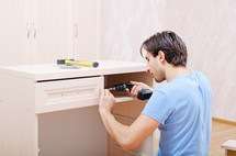 Man assembling furniture.