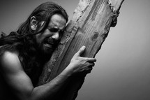 The suffering of Christ -- Jesus crying in pain while carrying the cross.