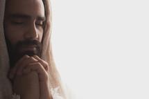 Hood Jesus praying.