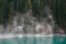 rising mist from alpine lake