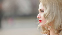 face of a young woman with red lipstick