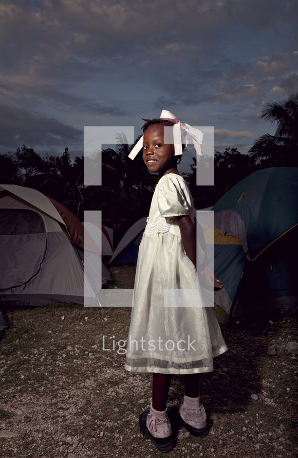 Young girl standing in camp ground
