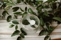 floating votive candle and greenery