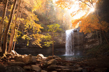 Waterfall surrounded by autumn foliage