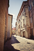 cobblestone streets between buildings