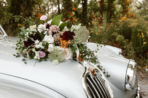 bridal bouquet on a vintage car