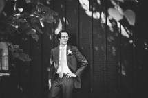 a groom standing outdoors posing