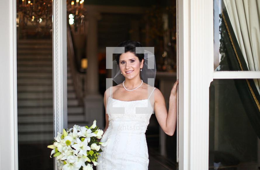 bride standing in a doorway outdoors