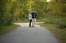 couple standing on a rural road - trees