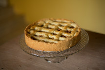 a pie on a cake stand