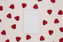 red heart shaped chocolates and white paper