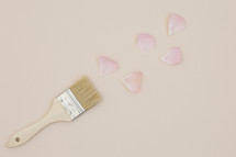 paint brush and pink petals