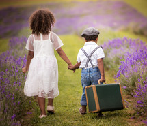 brother and sister portrait in a lavender field