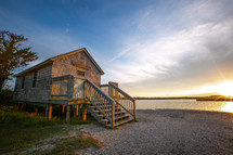 Side view of small wooden naturalist shack on the shore of Assateague Island, Maryland
