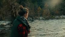 girl walking by riverbanks
