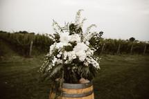 flower arrangement on a wine barrel