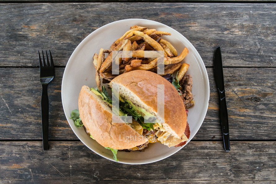 Hamburger and french fries on a plate