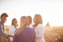 women standing outdoors in a field under intense sunlight