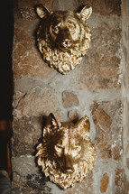 gold wolf and bear head decor