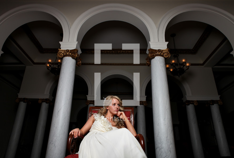 bride sitting in a red chair