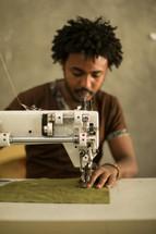man at a sewing machine