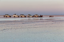 vehicles on a salt lake shore in Ethiopia