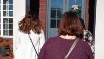 women entering a church through doors