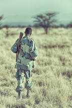 soldier with a gun in Africa