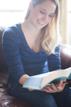 a woman reading Bible at a Bible study