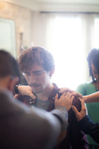 hands on a man in prayer